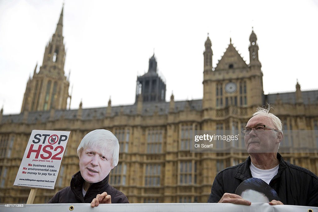 Protesters against the Government's proposed high-speed rail link (HS2) demonstrate outside the Houses of Parliament on April 28, 2014 in London, England. The House of Commons will vote later today on the HS2 bill's second reading with 30 Conservative MPs threatening to vote against the Government's pro-HS2 stance.