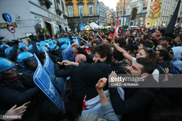 Protesters against the Italian Interior minister and deputy prime minister clash with riot police in downtown Naples on May 16 2019 The removal of a...