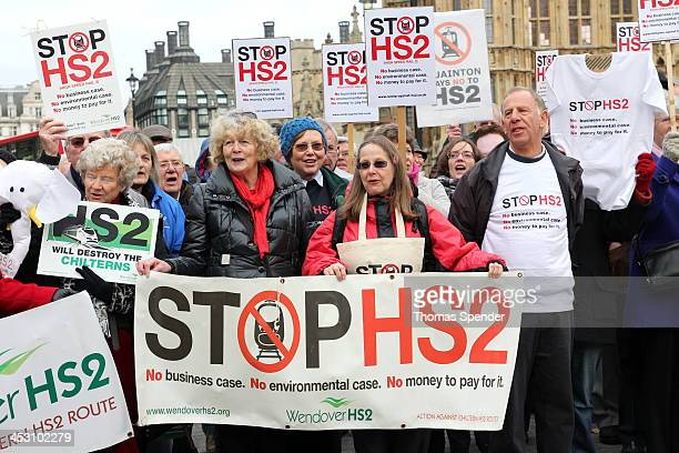 CONTENT] Protesters against the planned HS2 high speed rail link between London and Birmingham protest outside the Houses of Parliament The...