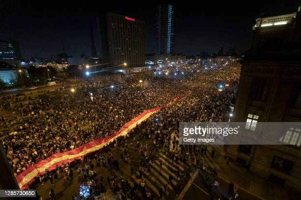 Protesters against the removal of President Martin Vizcarra march with a giant national flag as they gather in front of Palacio de Justicia on...