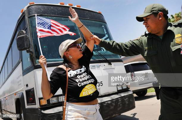 Protesters against the Trump administration's border policies try to block a bus carrying migrant children out of a US Customs and Border Protection...
