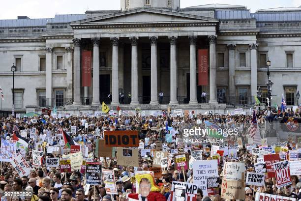 Protesters against the UK visit of US President Donald Trump gather in Trafalgar Square after taking part in a march in London on July 13 2018 Tens...