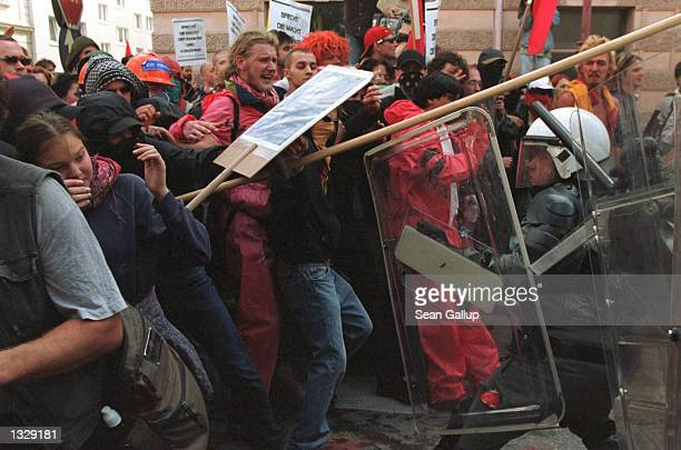 Protesters against the World Economic Forum battle police July 1 2001 in Salzburg Austria where the WEF was convening for its first day of sessions...