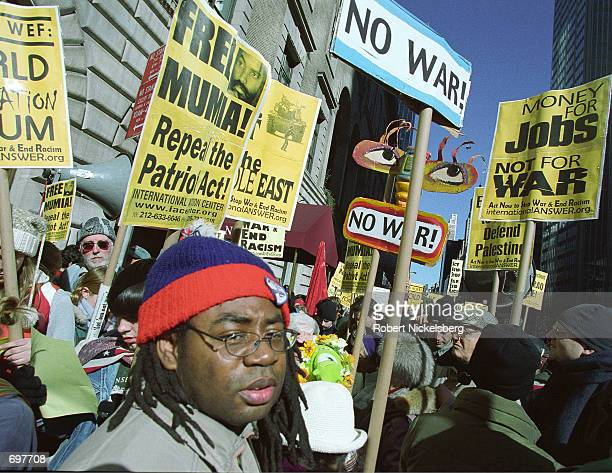 Protesters against the World Economic Forum demonstrate February 2 2002 in front of the Waldorf Astoria Hotel in New York Police arrested 27...
