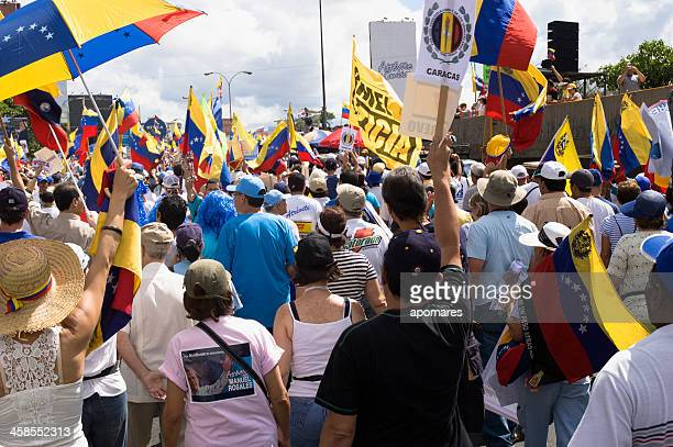 protesters against venezuelan government in a multitudinous parade - venezuela stock pictures, royalty-free photos & images