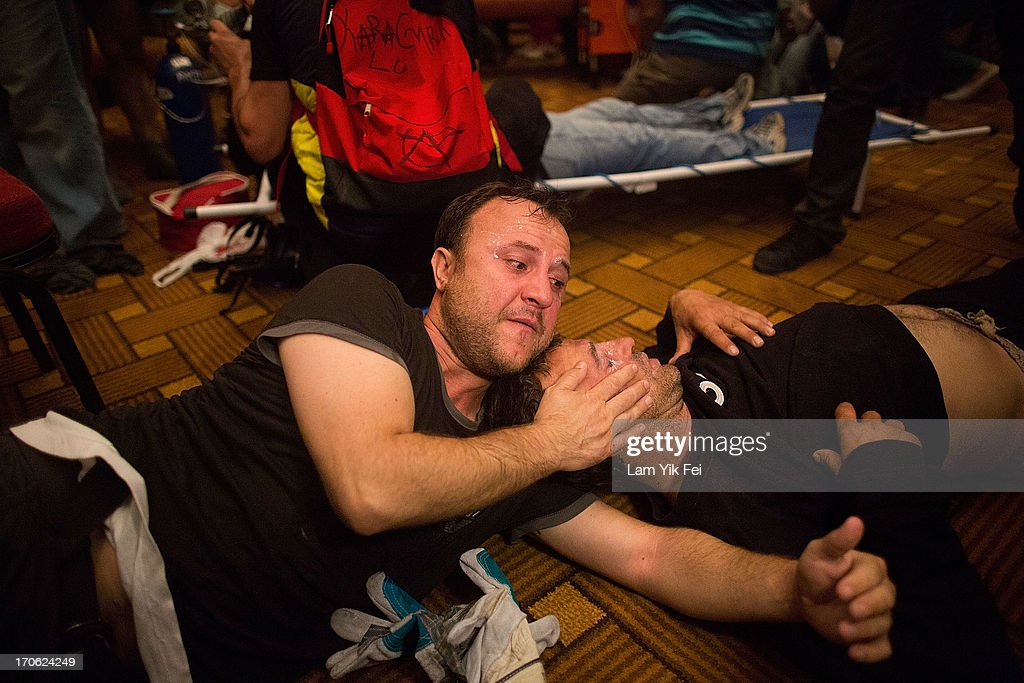 Protesters aid one another in the Divan Istanbul Hotel after riot police used tear gas to disperse the crowd near the Gezi Park on June 15, 2013 in Istanbul, Turkey. Istanbul has seen protests rage on for days, with two protesters and one police officer killed. What began as a protest over the fate of Taksim Gezi Park turned into a wider demonstration over Prime Minister Recep Tayyip Erdogan's policies. Erdogan has delivered a final warning after a 24-hour deadline to clear Taksim Square and Gezi Park passed.