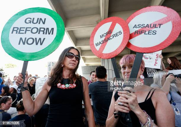 Protesters Alessandra Mondolfi and Mercedes kent hold signs at a rally for gun control at the Broward County Federal Courthouse in Fort Lauderdale...