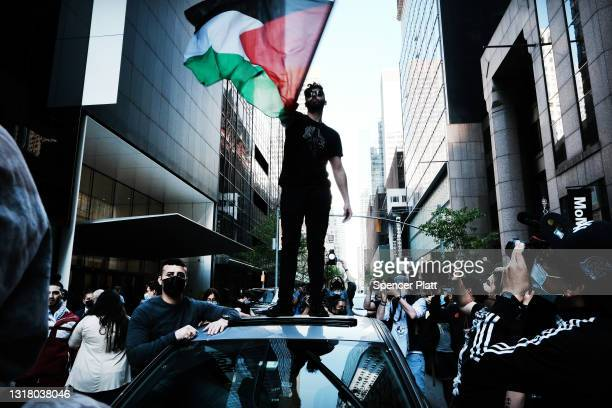 Protesters and activists gather to voice their anger at the situation in Israel and to defend the Palestinian resistance movement on May 14, 2021 in...