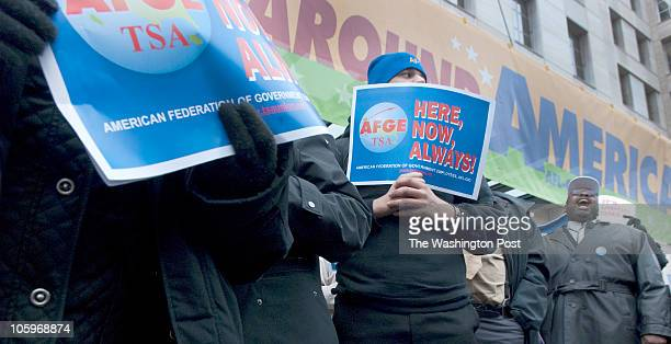Protesters and American Federation of Government Employees rally for bargaining rights in front of the AFLCIO building