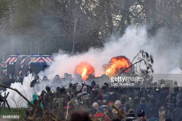 Protesters and gendarmes clash on April 11 during a police operation to raze the decade-old anti-capitalist camp known as ZAD set up to protest a new...