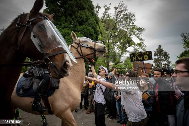 Protesters and members of Victoria Police clash on October 23, 2020 in Melbourne, Australia. Protesters are calling on the end to lockdown...