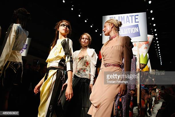 Protesters and models walk the runway at the Vivienne Westwood Red Label show during London Fashion Week Spring/Summer 2016 on September 20 2015 in...