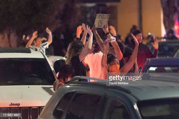 Protesters and motorists who were order out of their cars are surrounded by police and arrested as large numbers of people are rounded up after a...