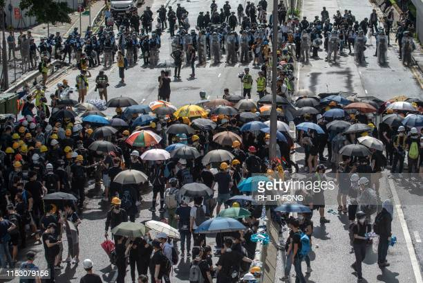 Protesters and police faceoff at Harcourt Road outside the government headquarters after the annual flag raising ceremony to mark the 22nd...