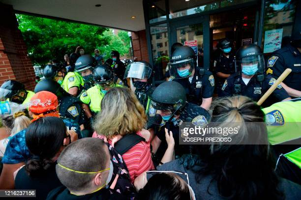 Protesters and police officers clash outside District Four Police station during a demonstration against police brutality and racism in the US, with...