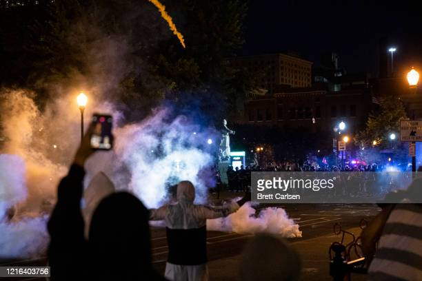 Protesters and police stand off as tear gas is deployed in the streets on May 30, 2020 in Louisville, Kentucky. Protests have erupted after recent...