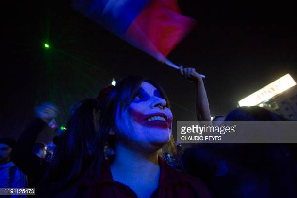 Protesters and revelers take part in a rally while enjoying the New Year's celebration in Santiago on December 31 2019 Chile has been rocked by...