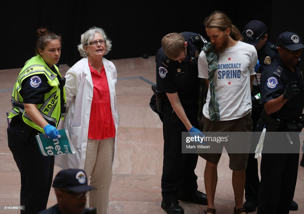 Protesters are arested for demonstrating inside the Hart Senate Office Building on July 17, 2017 in Washington, DC. Capitol Police arrested several protesters at various Senate offices as they asked Senators to vote no on the Better Care Reconciliation Act.