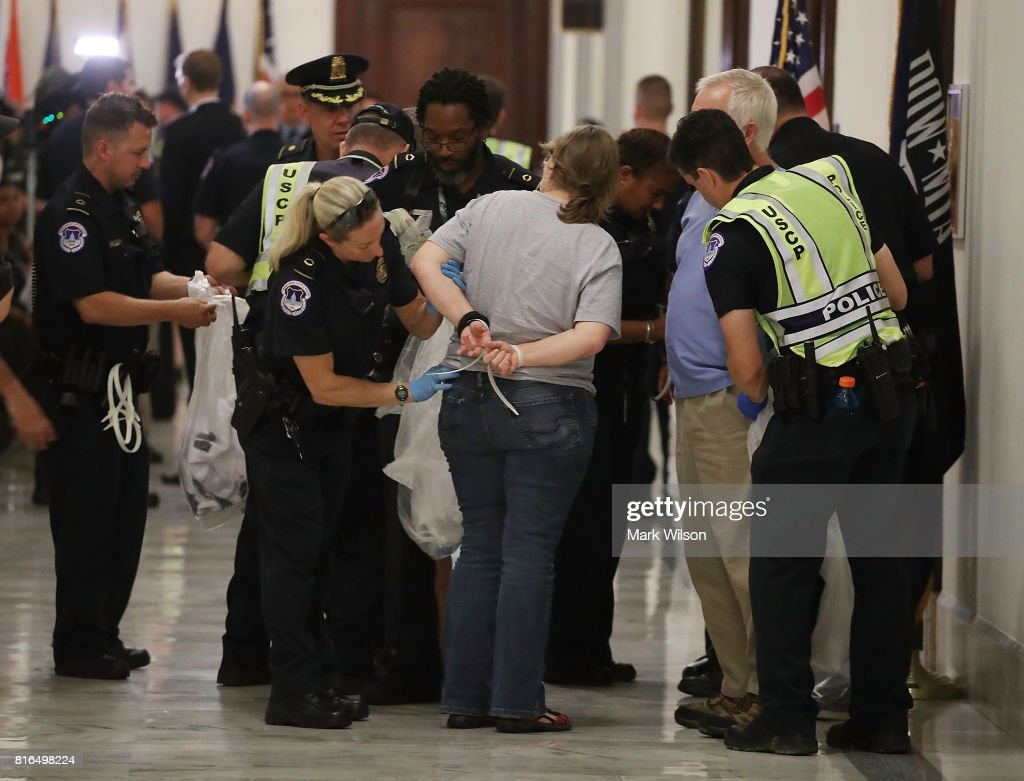 Protesters are arrested for demonstrating outside the office of Sen. Pat Toomey (R-PA) inside the Russell Senate Office Building on July 17, 2017 in Washington, DC. Capitol Police arrested several protesters at various Senate offices as they asked Senators to vote no on the Better Care Reconciliation Act.