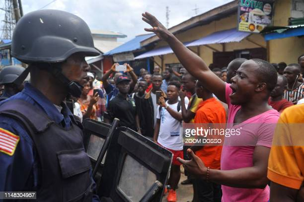 Protesters are confronted by Liberian police forces during a demonstration in Monrovia on June 5 ahead of a large anti-government protest expected...