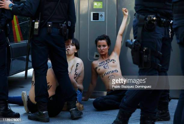 FEMEN protesters are detained by police after disrupting the VOX closing rally on April 26 2019 in Madrid Spain Spaniards go to the polls to elect...