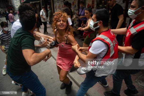 Protesters are detained by police in central Istanbul, on June 26 as hundreds of LGTBI activists defied a ban and tried to stage a gay pride event.