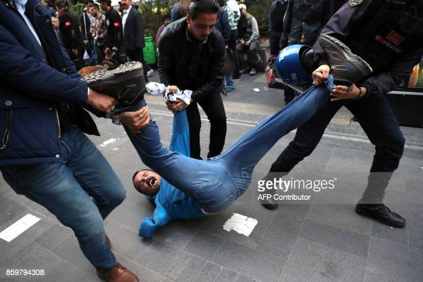 TOPSHOT Protesters are detained by Turkish police as they demonstrate against the detention of hungerstriking teacher Semih Ozakca and literature...