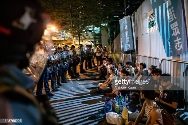 Protesters are detained during a clash after a rally against the extradition law proposal at the Central Government Complex on June 10 2019 in Hong...