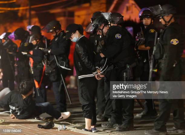 Protesters are detained for breaking curfew while protesting the killing of George Floyd at S 9th St and Elizabeth St in downtown San Jose Calif on...