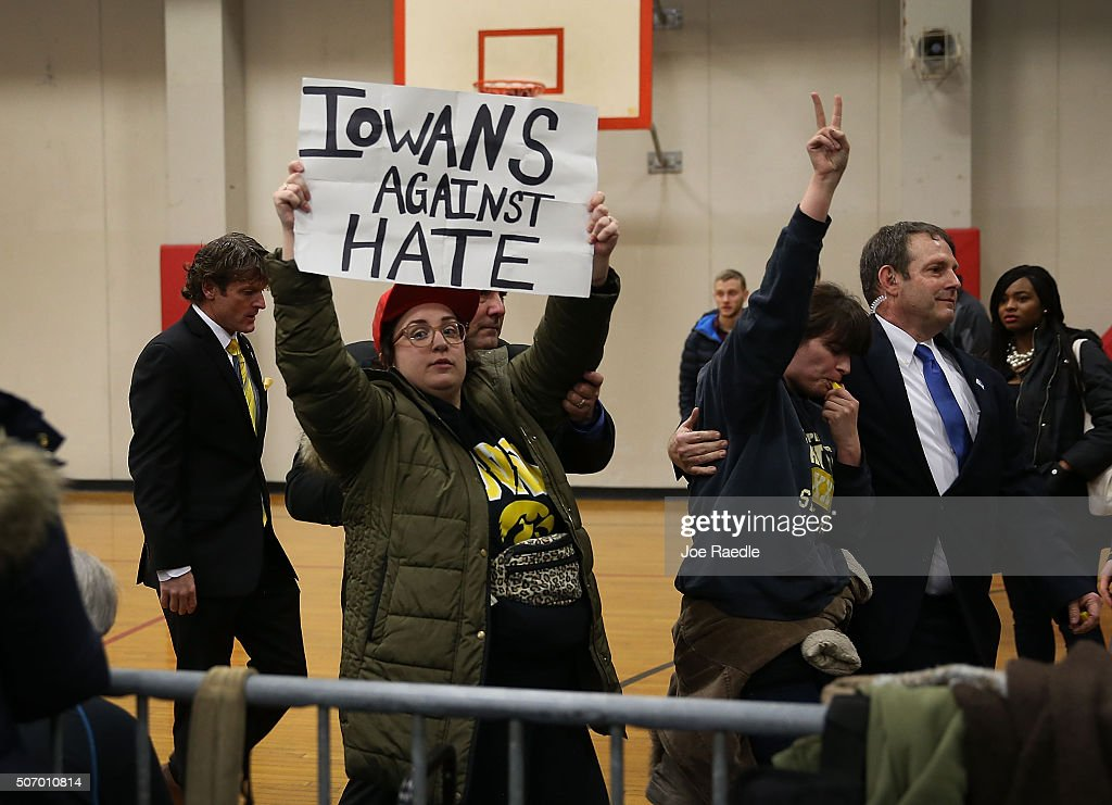 Protesters are escorted out after interrupting a Republican presidential candidate Donald Trump campaign event at the University of Iowa on January 26, 2016 in Iowa City, Iowa. Trump continues his quest to become the Republican presidential nominee.