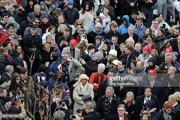 Protesters are escorted out of the audience as US President Donald Trump takes the oath of office on the West Front of the US Capitol on January 20...