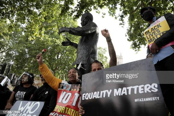 Protesters are gathering in Parliament Square to commemorate the life of George Floyd at 5pm, the time when his body will be laid to rest in Houston,...