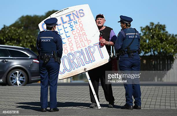 Protesters are moved to the footpath by police outside the Vodafone Events Centre as they wait for the arrival of Leader of the National Party John...