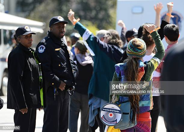 Protesters are processed for arrest by police during a Democracy Spring demonstration on Capitol Hill in Washington DC on April 13 calling to change...