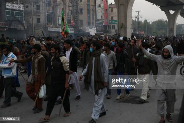 Protesters are seen after security forces launched a crackdown on Saturday morning against protesters who had been blocking the main entrance from...