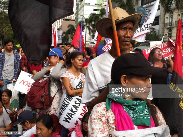 Protesters are seen attentively listening to the speeches of their leaders during the protest Leftist groups stage Bonifacio Day of protest in...