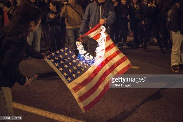 Protesters are seen burning an American flag during the protest Thousands of people have demonstrated during the 45th anniversary of the Polytechnic...