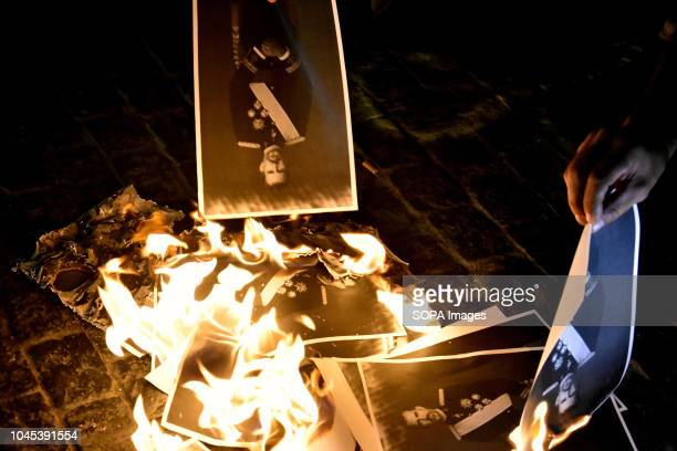 Protesters are seen burning photos of the king of Spain Felipe VI during the protest Hundreds of people gather at the Government headquarters of...