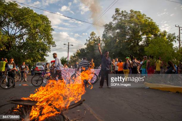 CHICHIGALPA CHINANDEGA NICARAGUA Protesters are seen burning trees on the street as demonstrations and clashes with the police have become too common...