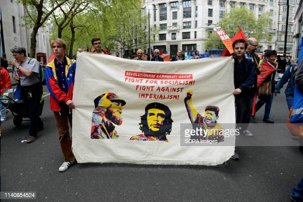 Protesters are seen carrying a huge banner during the rally Protesters marched through central London to a rally in Trafalgar Square demanding better...