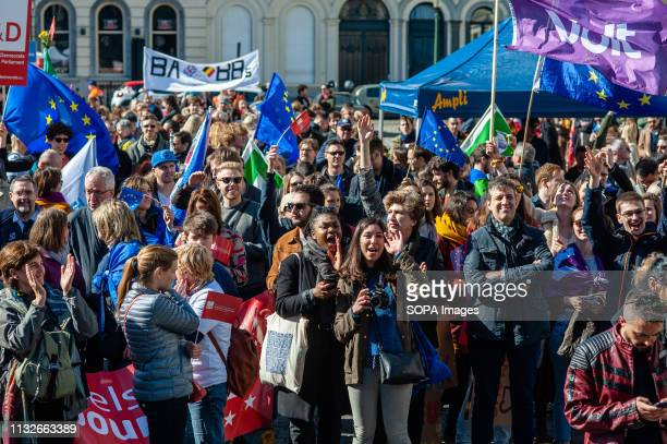 Protesters are seen clapping hands after the speeches during the protest A day before the anniversary of the founding Treaty of the European Union...