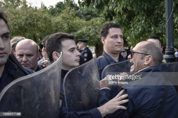 Protesters are seen clashing with the police men during against primary house auctions at the students parade in Athens