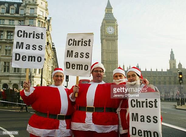 Protesters are seen during a Fathers 4 Justice christmas campaign march, from the Church of England headquaters in Westminster to St Paul's...