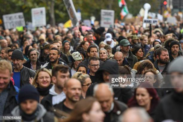 Protesters are seen during a Unite for Freedom march on October 24, 2020 in London, England. Hundreds of anti-mask and anti-lockdown protesters...