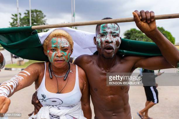 Protesters are seen during the ongoing protest against the unjust brutality of The Nigerian Police Force Unit , the Special Anti-Robbery Squad , at...