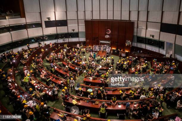 Protesters are seen gather inside the chamber of the Legislative Council in Hong Kong China 2 July 2019 Thousands of protesters storm the Legislative...