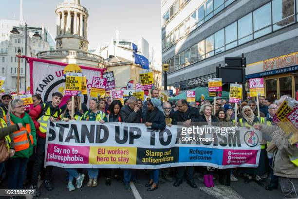 Protesters are seen holding a banner and placards during the protest Huge crowds marched from the BBC in Portland Place to Whitehall with flags and...