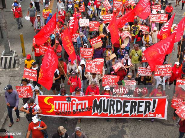 MENDIOLA MANILA PHILIPPINES Protesters are seen holding a banner and placards flags during the protest Leftist groups stage Bonifacio Day of protest...