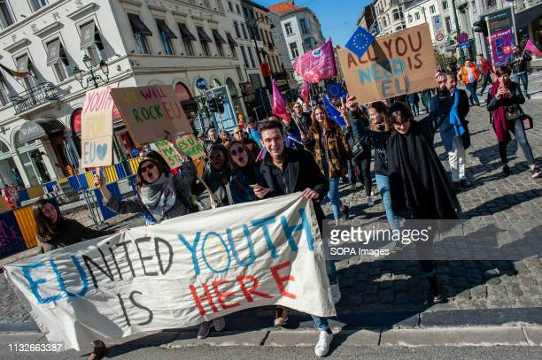 Protesters are seen holding a banner and placards while shouting slogans during the protest A day before the anniversary of the founding Treaty of...