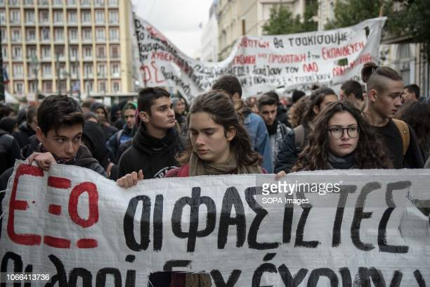Protesters are seen holding a banner during the protest Hundreds of students protest against the rise of fascism and racism in schools